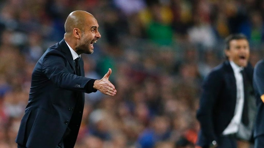 Bayern's head coach Pep Guardiola instructs his players during the Champions League semifinal first leg soccer match between Barcelona and Bayern Munich at the Camp Nou stadium in Barcelona, Spain, Wednesday, May 6, 2015.  (AP Photo/Manu Fernandez)