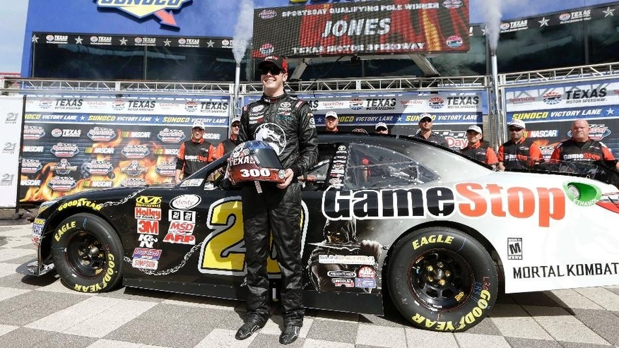 FILE - In this April 10, 2015, file photo, NASCAR XFinity Series driver Erik Jones poses for photos after winning the pole position for the O'Reilly Auto Parts 500 auto race at Texas Motor Speedway in Fort Worth, Texas. Not only are youngsters Daniel Suarez and Erik Jones starting in Friday night's, May 8, 2015,  Truck Series race, it will be the 18-year-old Jones making his Sprint Cup debut in place of Kyle Busch on Saturday night.(AP Photo/Tim Sharp, File)