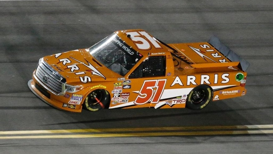 FILE - In this Feb. 20, 2015, file photo, Daniel Suarez, of Mexico, drives during the NASCAR Trucks Series auto race at Daytona International Speedway in Daytona Beach, Fla. Not only are youngsters Daniel Suarez and Erik Jones starting in Friday night's, May 8, 2015,  Truck Series race, it will be the 18-year-old Jones making his Sprint Cup debut in place of Kyle Busch on Saturday night. (AP Photo/John Raoux, File)