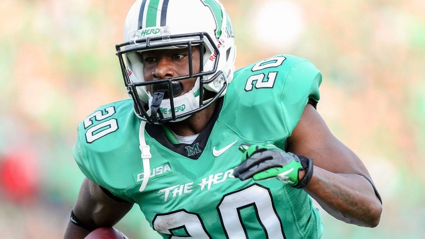 Sept. 7, 2013: Marshall football player Steward Butler runs for a touchdown against Gardner-Webb in an NCAA college football gamen in Huntington, W.Va.