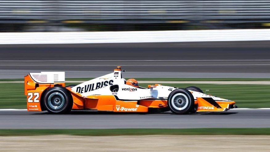 Simon Pagenaud, of France, drives through a turn during practice for the Grand Prix of Indianapolis auto race at the Indianapolis Motor Speedway in Indianapolis, Thursday, May 7, 2015.  (AP Photo/Michael Conroy)