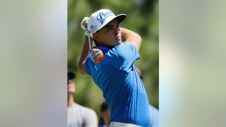 Rickie Fowler hits from the fourth tee during the first round of The Players Championship golf tournament Thursday, May 7, 2015, in Ponte Vedra Beach, Fla., Fla. (AP Photo/Chris O'Meara )