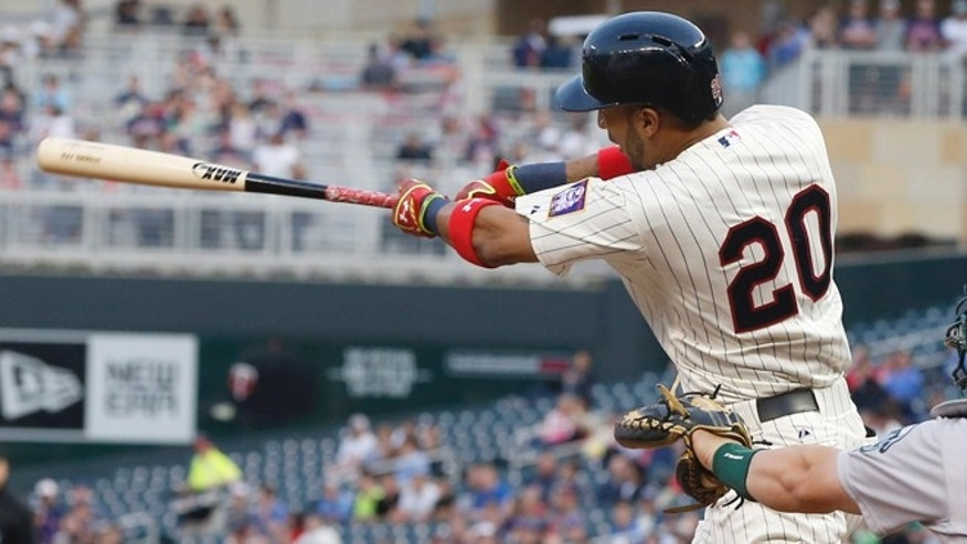 Minnesota Twins' Eddie Rosario hits his first major league home run on the first pitch off Oakland Athletics pitcher Scott Kazmir in the third inning of a baseball game, Wednesday, May 6, 2015, in Minneapolis. (AP Photo/Jim Mone)