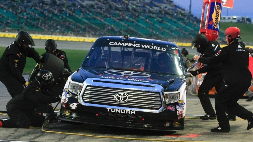 NASCAR driver Erik Jones (4) pits during a Truck Series auto race at Kansas Speedway in Kansas City, Kan., Friday, May 8, 2015. (AP Photo/Colin E. Braley)