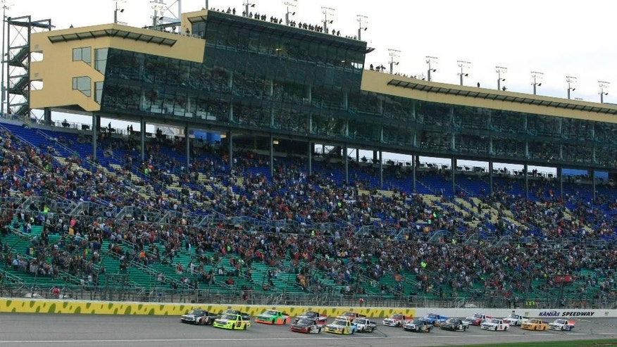 NASCAR drivers take the green flag at the start of a Truck Series auto race at Kansas Speedway in Kansas City, Kan., Friday, May 8, 2015. (AP Photo/Colin E. Braley)