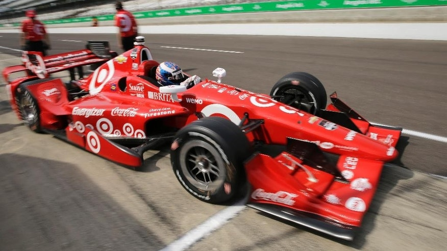 Scott Dixon, of New Zealand, pulls out of the pits during practice for the Grand Prix of Indianapolis auto race at the Indianapolis Motor Speedway in Indianapolis, Friday, May 8, 2015.  (AP Photo/Darron Cummings)