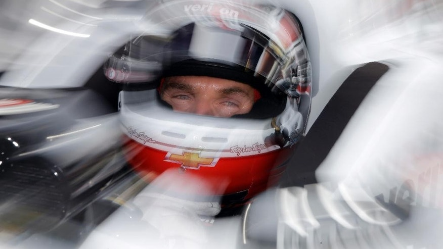 Will Power, of Australia, sits in his car during practice for the Grand Prix of Indianapolis auto race at the Indianapolis Motor Speedway in Indianapolis, Friday, May 8, 2015.  (AP Photo/Darron Cummings)