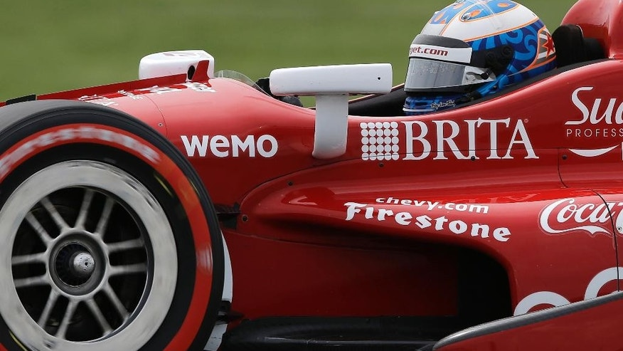 Scott Dixon, of New Zealand, steers his car during qualifying for the Grand Prix of Indianapolis auto race at Indianapolis Motor Speedway in Indianapolis, Friday, May 8, 2015.  (AP Photo/Darron Cummings)