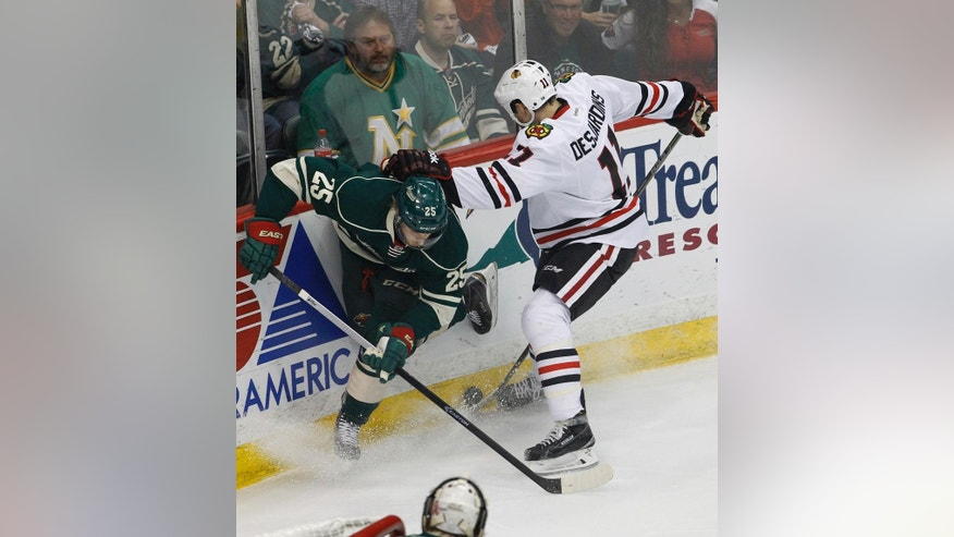Minnesota Wild defenseman Jonas Brodin (25) and Chicago Blackhawks center Andrew Desjardins (11) battle for the puck during the first period of Game 4 in the second round of the NHL Stanley Cup hockey playoffs Thursday, May 7, 2015, in St. Paul, Minn. (AP Photo/Ann Heisenfelt)