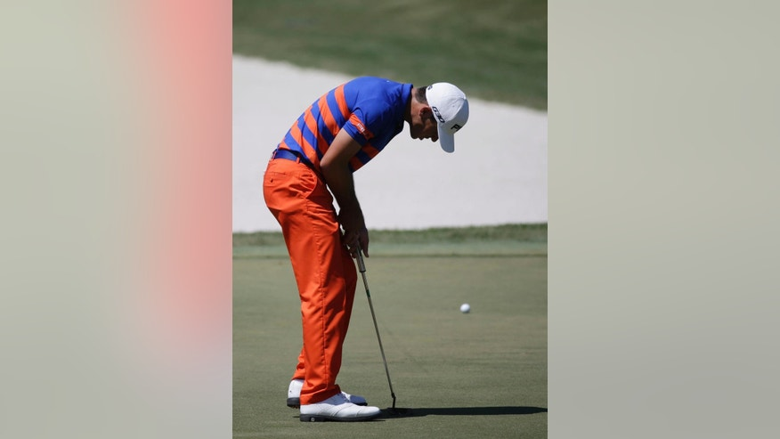 Billy Horschel reacts after missing his birdie putt on the 11th hole during the third round of The Players Championship golf tournament Saturday, May 9, 2015, in Ponte Vedra Beach, Fla. (AP Photo/John Raoux)