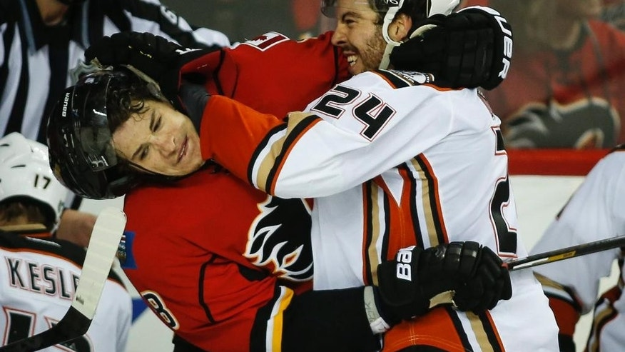 Anaheim Ducks' Simon Despres, right, and Calgary Flames' Joe Colborne scuffle during the second period of Game 4 of NHL hockey second-round playoff action in Calgary, Alberta, Friday, May 8, 2015. (Jeff McIntosh/The Canadian Press via AP) MANDATORY CREDIT