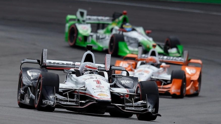 Will Power, of Australia, leads the field into a turn during the Grand Prix of Indianapolis auto race at Indianapolis Motor Speedway in Indianapolis, Saturday, May 9, 2015.  (AP Photo/Michael Conroy)