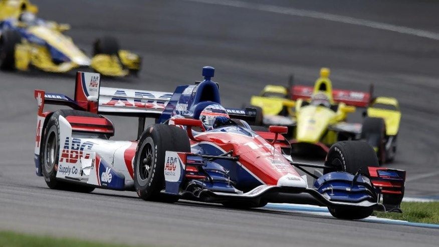 Takuma Sato, of Japan, heads into a turn during the Grand Prix of Indianapolis auto race at Indianapolis Motor Speedway in Indianapolis, Saturday, May 9, 2015.  (AP Photo/Michael Conroy)