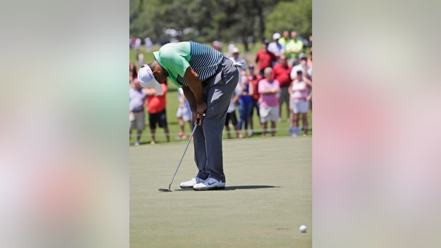 Tiger Woods reacts to a missed birdie putt on the 15th green during the third round of The Players Championship golf tournament Saturday, May 9, 2015, in Ponte Vedra Beach, Fla. (AP Photo/John Raoux