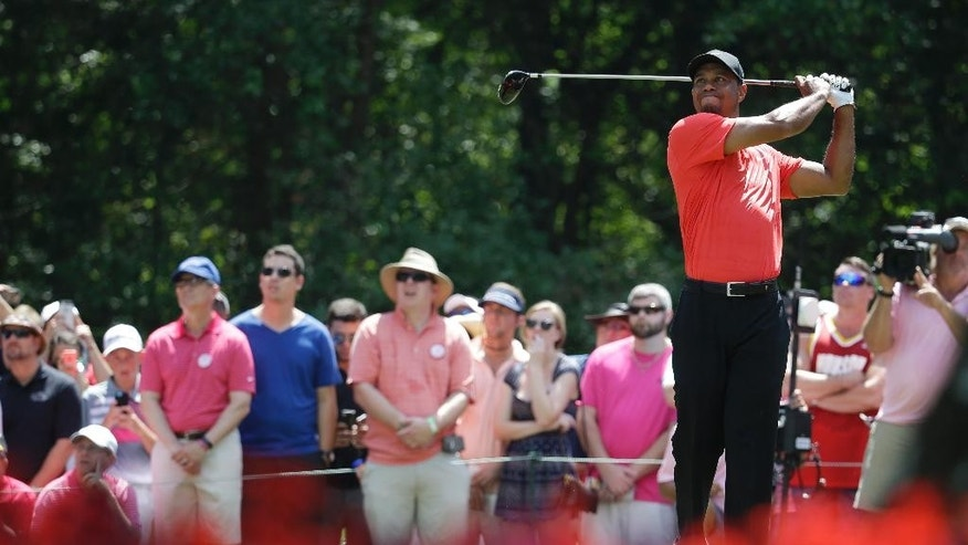 Tiger Woods hits off the 15th tee during the final round of The Players Championship golf tournament, Sunday, May 10, 2015, in Ponte Vedra Beach, Fla. (AP Photo/Lynne Sladky)