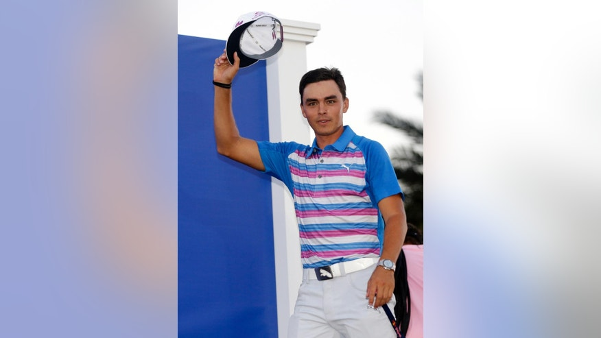 Rickie Fowler is introduced as The Players Championship golf tournament winner Sunday, May 10, 2015, in Ponte Vedra Beach, Fla. Fowler won in a sudden death playoff against Kevin Kisner. (AP Photo/Lynne Sladky)