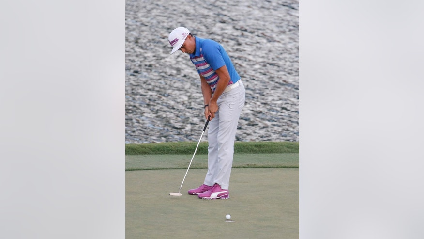Rickie Fowler makes his winning putt on the 17 green during the sudden death playoff round against Kevin Kisner at The Players Championship golf tournament Sunday, May 10, 2015, in Ponte Vedra Beach, Fla. Fowler won the tournament.  (AP Photo/Lynne Sladky)