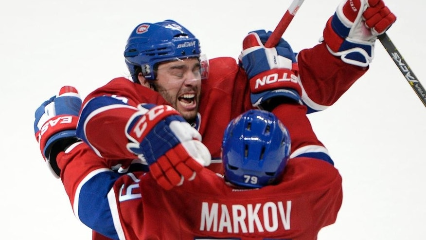 Montreal Canadiens right wing P.A. Parenteau (15) celebrates with Montreal Canadiens defenseman Andrei Markov (79) after scoring the winning goal against the Tampa Bay Lightning during the third period of Game 5 of a second-round NHL Stanley Cup hockey playoff series Saturday, May 9, 2015, in Montreal. (Ryan Remiorz/The Canadian Press via AP) MANDATORY CREDIT