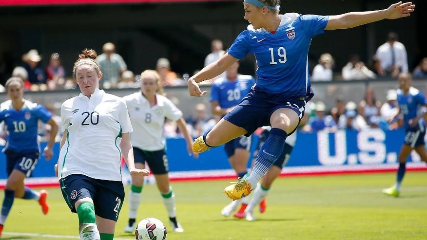 United States' Julie Johnston (19) shoots on goal as Ireland's Fiona O'Sullivan (20) defends during the first half of an exhibition soccer match Sunday, May 10, 2015, in San Jose, Calif.  (AP Photo/Tony Avelar)