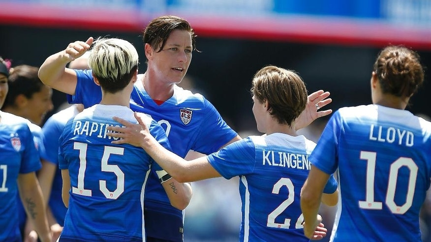 United States' Abby Wambach, center, is congratulated by teammates after scoring a goal against Ireland during the first half of an exhibition soccer match Sunday, May 10, 2015, in San Jose, Calif. (AP Photo/Tony Avelar)
