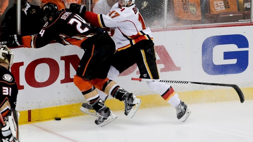 Calgary Flames left wing Lance Bouma, right, checks Anaheim Ducks defenseman Simon Despres during the first period of Game 5 in an NHL hockey second-round playoff series in Anaheim, Calif., Sunday, May 10, 2015. (AP Photo/Chris Carlson)