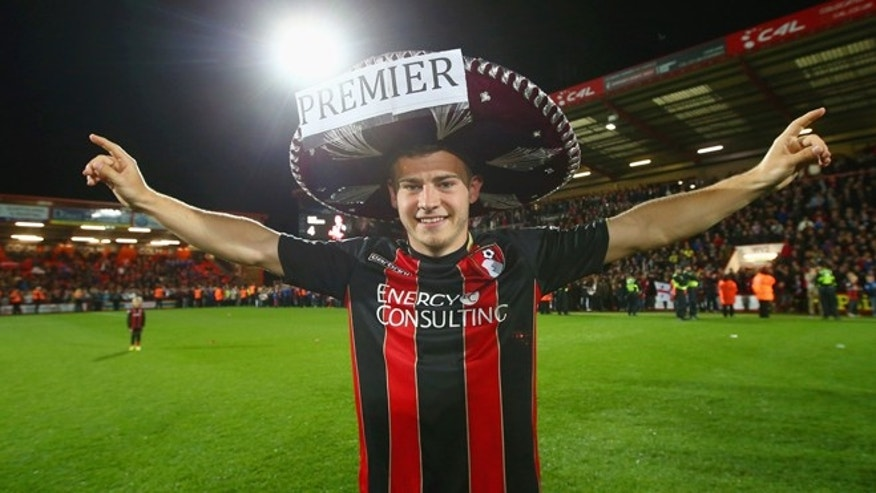 BOURNEMOUTH, ENGLAND - APRIL 27:  Ryan Fraser of Bournemouth celebrates victory on the pitch after the Sky Bet Championship match between AFC Bournemouth and Bolton Wanderers at Goldsands Stadium on April 27, 2015 in Bournemouth, England. Bournemouth's 3-0 victory puts them on the brink of promotion to the Barclays Premier League.  (Photo by Clive Rose/Getty Images)