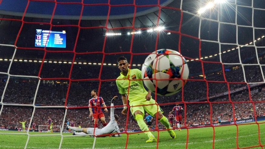 Barcelona's Neymar scores his side's opening goal during a Champions League semi final  second leg soccer match between Bayern Munich and FC Barcelona in Munich, Germany, Tuesday, May 12, 2015. (Tobias Hase /dpa via AP)