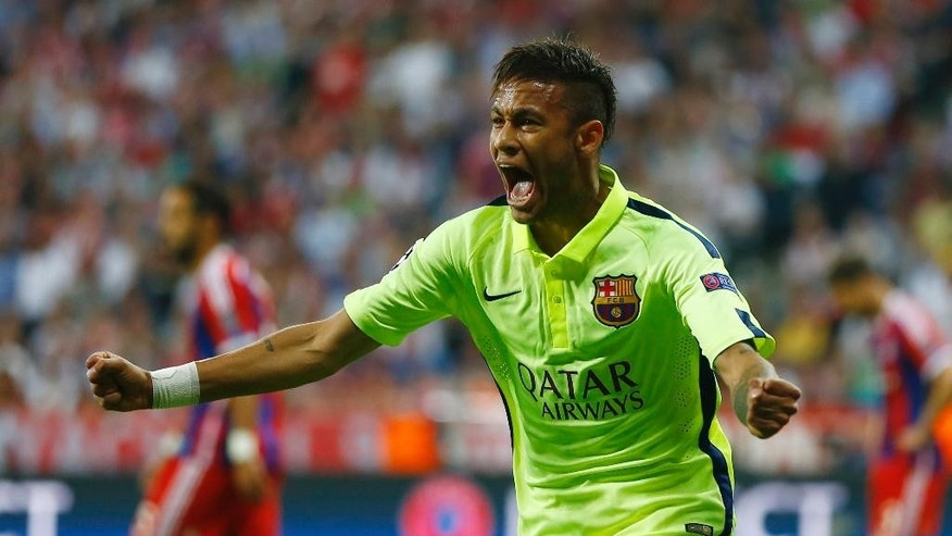 Barcelona's Neymar celebrates after scoring his side's first goal during the soccer Champions League second leg semifinal match between Bayern Munich and FC Barcelona at Allianz Arena in Munich, southern Germany, Tuesday, May 12, 2015. (AP Photo/Matthias Schrader)
