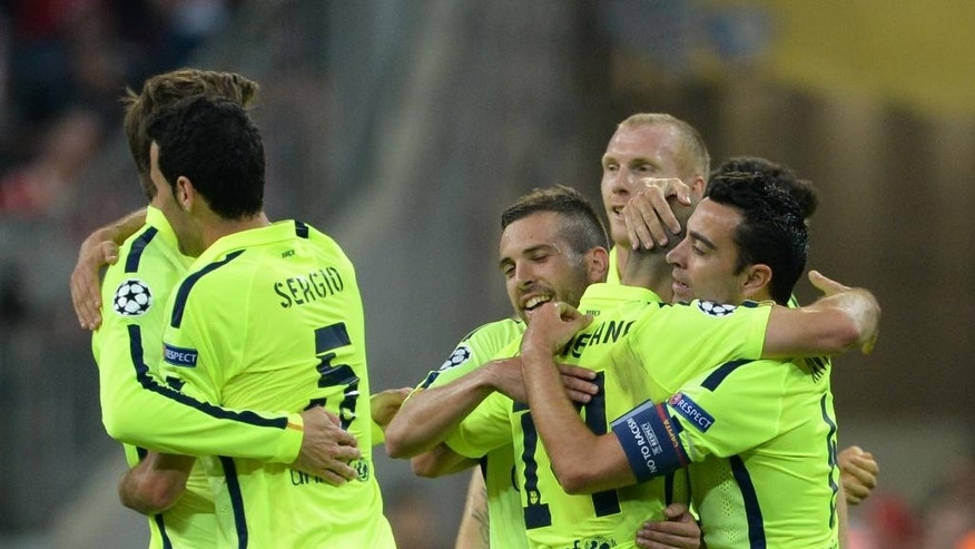 Barcelona's players celebrate after a Champions League semi-final  second leg soccer match between Bayern Munich and FC Barcelona in Munich, Germany, Tuesday, May 12, 2015. (Sven Hoppe /dpa via AP)