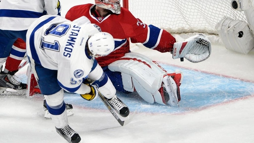 Tampa Bay Lightning center Steven Stamkos (91) scores a goal against Montreal Canadiens goalie Carey Price (31) during the third period of Game 5 of a second-round NHL Stanley Cup hockey playoff series Saturday, May 9, 2015, in Montreal. (Ryan Remiorz/The Canadian Press via AP) MANDATORY CREDIT