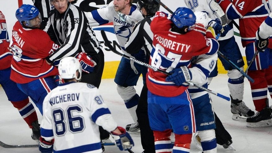 Montreal Canadiens and Tampa Bay Lightning players scuffle after the Canadiens won 2-1 in Game 5 of a second-round NHL Stanley Cup hockey playoff series Saturday, May 9, 2015, in Montreal. (Ryan Remiorz/The Canadian Press via AP) MANDATORY CREDIT