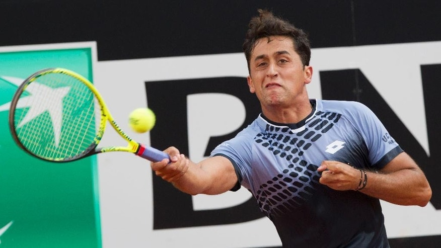 Spain's Nicolas Almagro returns the ball to Serbia's Novak Djokovic during their match at the Italian Open tennis tournament, in Rome, Tuesday, May 12, 2015. (AP Photo/Riccardo De Luca)