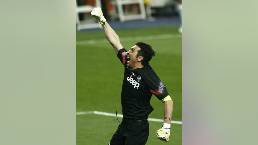 Juventus goalkeeper Gianluigi Buffon celebrates after his teammate Alvaro Morata scored during the Champions League second leg semifinal soccer match between Real Madrid and Juventus, at the Santiago Bernabeu stadium in Madrid, Wednesday, May 13, 2015.  (AP Photo/Oscar del Pozo)