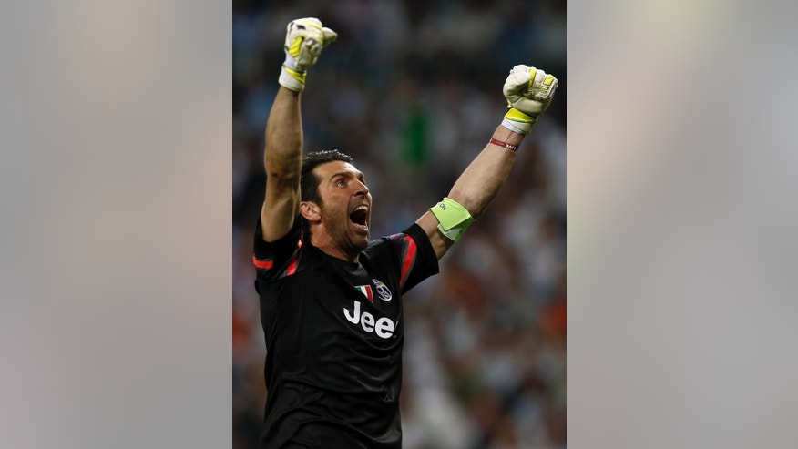 Juventus goalkeeper Gianluigi Buffon celebrates after his teammate Alvaro Morata scored during the Champions League second leg semifinal soccer match between Real Madrid and Juventus, at the Santiago Bernabeu stadium in Madrid, Wednesday, May 13, 2015. (AP Photo/Andres Kudacki)