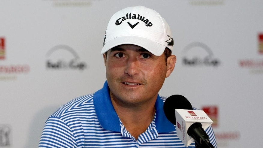 Kevin Kisner answers a question during a news conference for the Wells Fargo Championship golf tournament at the Quail Hollow Club in Charlotte, N.C., Wednesday, May 13, 2015. Kisner is looking to turn around his fortunes after losing in a playoff in two of his last three tournaments, including last week at the Players Championship. (AP Photo/Chuck Burton)