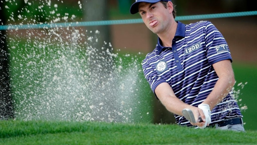 Webb Simpson hits from a sand trap on the fourth hole during the pro-am for the Wells Fargo Championship golf tournament at the Quail Hollow Club in Charlotte, N.C., Wednesday, May 13, 2015. (AP Photo/Chuck Burton)