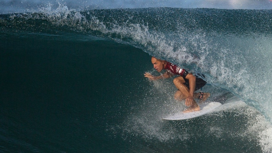U.S. surfer Kelly Slater competes in the 2015 Oi Rio Pro World Surf League competition at Barra da Tijuca beach in Rio de Janeiro, Brazil, Tuesday, May 12, 2015. (AP Photo/Leo Correa)