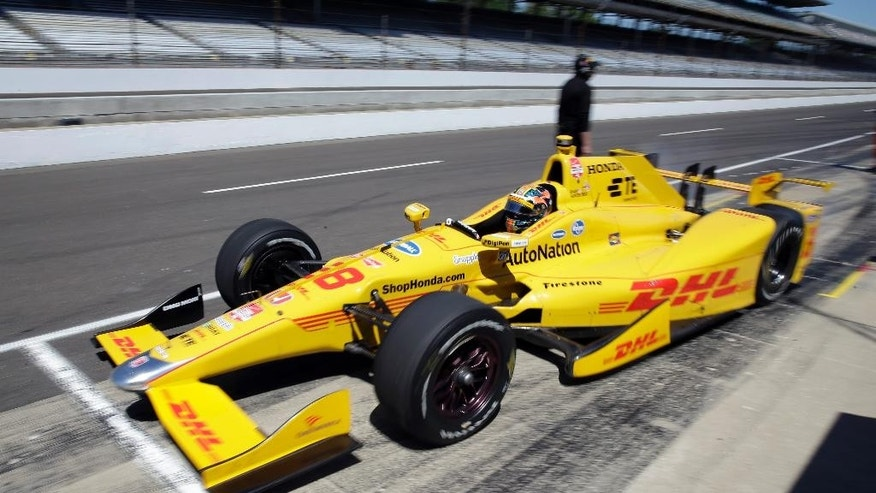 Ryan Hunter-Reay pulls out of the pit area during practice for the Indianapolis 500 auto race at Indianapolis Motor Speedway in Indianapolis, Wednesday, May 13, 2015.  (AP Photo/AJ Mast)