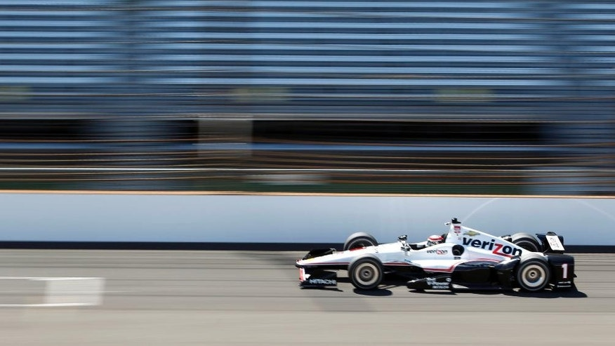 Will Power, of Australia, speeds down the main straightaway during practice for the Indianapolis 500 auto race at Indianapolis Motor Speedway in Indianapolis, Wednesday, May 13, 2015.  (AP Photo/AJ Mast)