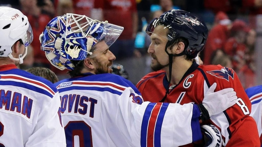 FILE - In this May 13, 2013, file photo, New York Rangers goalie Henrik Lundqvist (30), from Sweden, greets Washington Capitals left wing Alex Ovechkin (8), from Russia, after the Rangers won 5-0 in Game 7 in the first round of the NHL hockey Stanley Cup playoffs. While Ovechkin has guaranteed a win for the Capitals, the Rangers are a team that has beaten Washington twice, in the past three season in Game 7 playoff games. The clubs play Wednesday, May 13, in New York.(AP Photo/Alex Brandon, File)