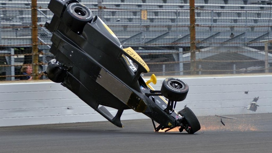 The car driven by Josef Newgarden begins to go airborne after hitting the wall in the first turn during practice for the Indianapolis 500 auto race at Indianapolis Motor Speedway in Indianapolis, Thursday, May 14, 2015.  (AP Photo/Marty Seppala)