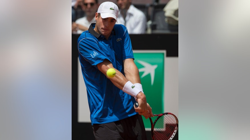 John Isner, of the United States, returns the ball to Rafael Nadal, of Spain, during their match at the Italian Open tennis tournament, in Rome, Thursday, May 14, 2015. (AP Photo/Andrew Medichini)