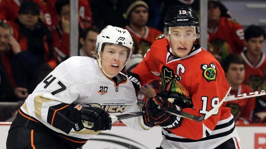 FILE - In this Jan. 17, 2014, file photo, Chicago Blackhawks' Jonathan Toews, right, and Anaheim Ducks' Hampus Lindholm watch the puck during the second period of an NHL hockey game in Chicago. Anaheim and Chicago will meet in the 2015 Western Conference Finals.  (AP Photo/Nam Y. Huh, File)