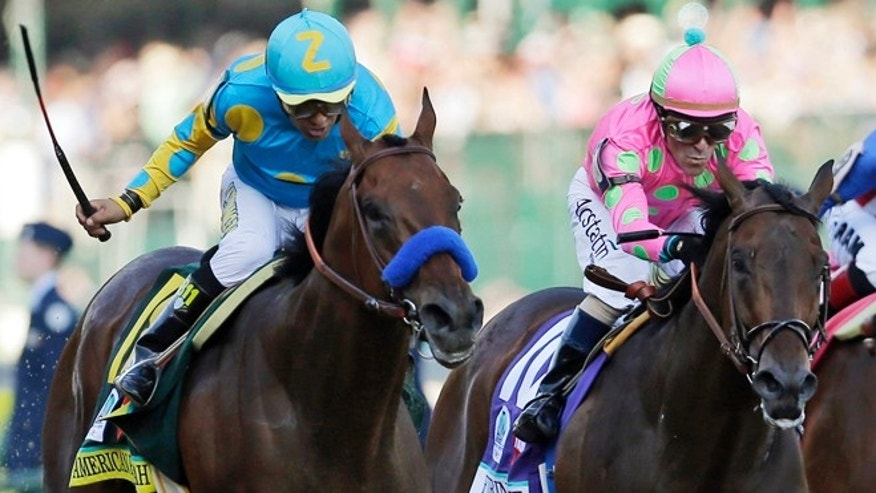 FILE - In this photo taken Saturday, May 2, 2015, jockey Victor Espinoza, left, rides American Pharoah to victory ahead of jockey Gary Stevens and Firing Line, during the 141st running of the Kentucky Derby horse race at Churchill Downs in Louisville, Ky. Stevens nearly won another Derby two weeks ago aboard Firing Line. The 52-year-old rider knows his way around Pimlico Race Course, too, and says his once-aching knees are feeling great and heâs ready to go in the Preakness. (AP Photo/Jeff Roberson, File)