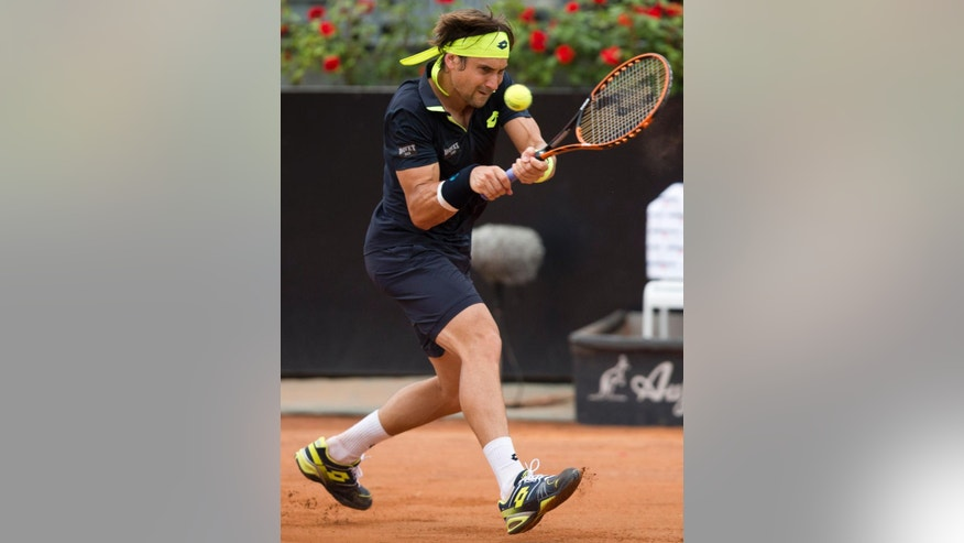 David Ferrer, of Spain, returns the ball to David Goffin, of Belgium, during a quarter final tennis match at the Italian Open tennis tournament, in Rome, Friday, May 15, 2015. (AP Photo/Andrew Medichini)