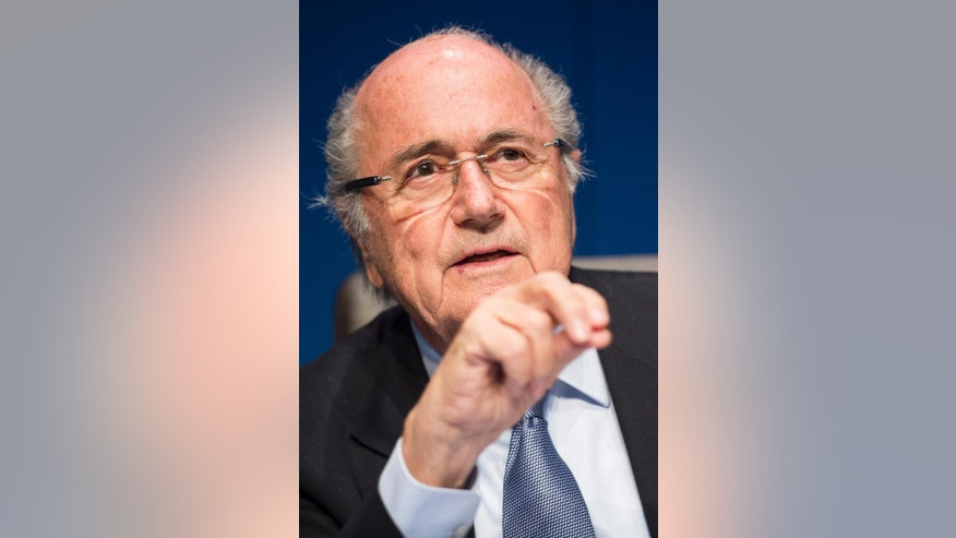 FILE - In this March 20, 2015 file photo FIFA President Joseph Blatter speaks to journalists following the FIFA Executive Committee meeting in Zurich, Switzerland. Blatter told Tuesday's May 12, 2015 edition of free Swiss daily 20 Minutes that his presidency benefited from a boom in soccer's finances and development fueled by television rights deals. (Ennio Leanza/Keystone via AP, File)