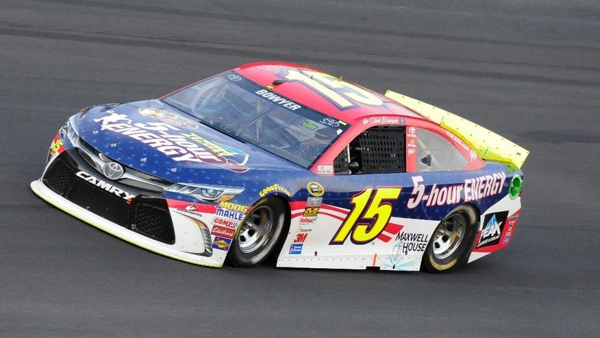 Clint Bowyer (15) drives through Turn 4 during the NASCAR Sprint Showdown auto race at Charlotte Motor Speedway in Concord, N.C., Friday, May 15, 2015.  Bowyer won the second segment to advance to Saturday's All-Star Race. (AP Photo/Mike McCarn)