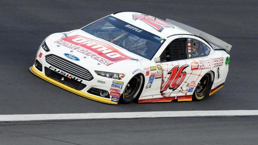 Greg Biffle (16) drives through Turn 4 during the NASCAR Sprint Showdown auto race at Charlotte Motor Speedway in Concord, N.C., Friday, May 15, 2015. Biffle won the first segment to advance to Saturday's All-Star Race. (AP Photo/Mike McCarn)