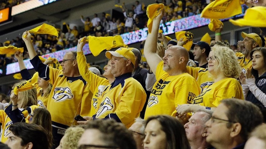 FILE - In this April 17, 2015, file photo, Nashville Predators fans cheer during Game 2 of an NHL Western Conference hockey playoff series against the Chicago Blackhawks in Nashville, Tenn. The Predators filled their building to 98.5 percent of capacity this season with a franchise-record 30 sellouts and have reached the playoffs eight of the past 11 seasons. (AP Photo/Mark Humphrey, File)