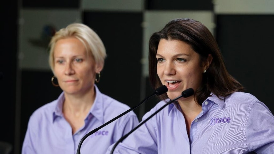 Driver Katherine Legge, right, and Beth Paretta announce the formation of Grace Autosport, the first all female IndyCar Series racing team during a press conference at Indianapolis Motor Speedway in Indianapolis, Friday, May 15, 2015.  (AP Photo/Michael Conroy)